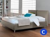 Letto matrimoniale contenitore Noctis modello London bed con rete a doghe, testata a cuscinoni e piedini sollevati per facilitare la pulizia. Disponibile anche in misura King Size